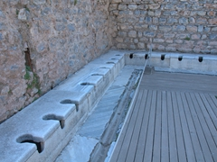 Toilets galore in ancient Ephesus (apparently the wealthy could reserve their favorite shitter!)