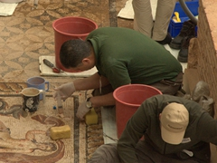 Workers painstakingly cleaning mosaics at the Terraced Houses; Ephesus