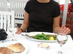 Becky sports a huge grin as she is about to tuck into her sea bass; Fethiye Fish Market