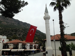 Turkish flag next to the town mosque; Kas