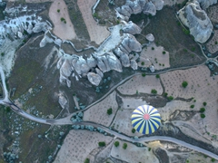 Soaring directly above another hot air balloon; Cappadocia