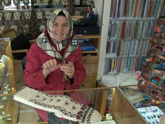 Buying hand knitted woolen socks; Cappadocia