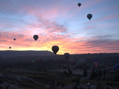 And they are off! Hot air balloons rising in the sky before sunrise; Cappadocia