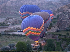 Early morning view of the hot air balloons gettting ready for lift off; Cappadocia