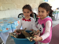 Two adorable girls show us their baby bunnies; Çavuşin village