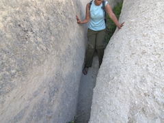 Becky squeezing through a tight crevice; Cappadocia