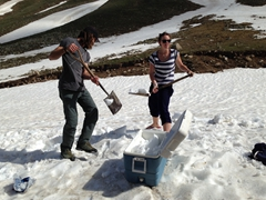 Kyle and Kate shoveling snow into the coolers; Kackar Mountains