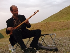 This friendly guy visited our bush camp to welcome us to Iran with some music