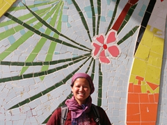 Becky at a colorful mural; Tabriz