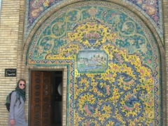 Helen poses by a intricately tiled women's WC; Golestan Palace