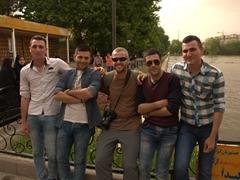 Robby befriending some Iranians at Shah Gölü Park; Tabriz