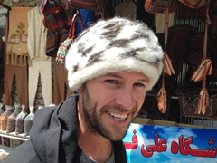 Robby models a wool hat; Kandovan