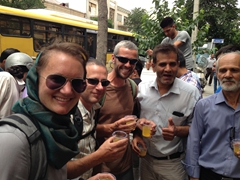 Helen, Anthony and Robby enjoying free road side drinks during a religious festival in Tehran