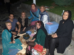 Becky posing with a group of Iranians who fed us all yummy homemade dolme (meat and rice stuffed in vine leaves)