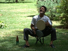 A drummer performing in the gardens of Hasht Behesht Palace