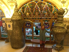 Becky posing between two massive vases; Bastani Traditional Restaurant