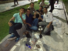 Friendly men inviting us to smoke shisha with them; Zayandeh riverbank