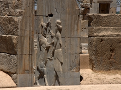 Stabbing a horse bas-relief; Persepolis