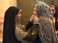 Gill getting a little help with her chador; Shah-e-Cheragh Shrine
