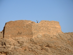 Anthony jumping around on his Zoroastrian Tower of Silence, southern outskirts of Yazd