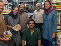 Robby, Kate and Becky posing with our new friend Medi and the shop keepers after buying some delicious Sohan; Yazd