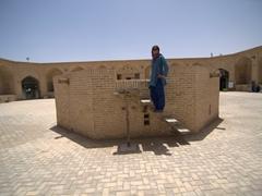 Becky climbing the qanat; Meybod caravanserai