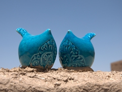 Ceramic birds on top of a Yazd roof