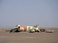 Remains of a doomed aircraft at the crash site of the ill fated US hostage resuce mission; Tabas Desert