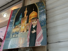 Superimposing children's photos at the Shrine of Imam Reza is a popular activity for many of the Shia Muslims visiting Mashhad