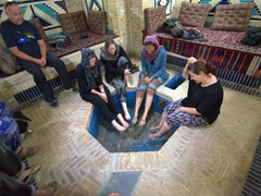 Kate, Gill, Becky and Dya soaking their feet in a qanat (underground water channel); Vali Traditional Hotel