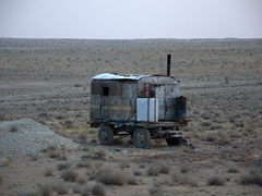 A railway wagon used as a makeshift dwelling; Darvaza