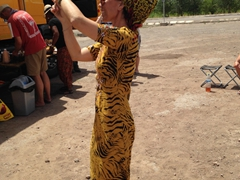 A gorgeous Turkmen lady takes photos of our group during a roadside lunch stop. Check out her amazing headdress!