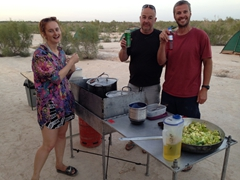 Cook group 2 - Kate, Andy and Robby prepare dinner in the sweltering heat