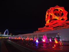 Yyldyz Hotel and the Wedding Palace lit up at night; Ashgabat