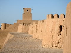 Mud built walls of Khiva with Kuhna Ark's watchtower in the background