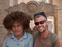 Robby strikes a pose with a friendly Uzbek man