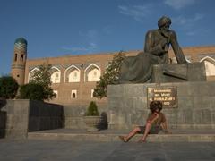 Robby mimics al Xorazmiy's pose; Khiva