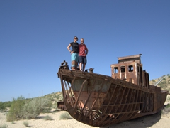 Posing on a beached ship, a poignant reminder of the Aral Sea disaster. The town of Moynaq used to be one of the Aral Sea's major fishing ports but today, it lies almost 200km away from the water