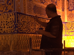 Painter hard at work at Tilla-Kari Medressa; Registan