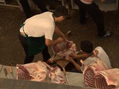 Butchers handling meat; Chorsu Bazaar