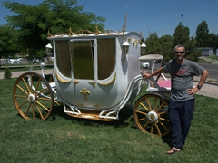 Robby by an old carriage in Tashkent