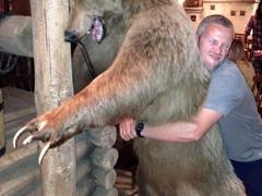 Robby gives a proper bear hug; Tashkent pub