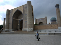 Old man walking in front of the massive Bibi-Khanym Mosque; Samarkand
