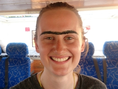 Kate gets a unibrow courtesy of several Kazakh women. Kazakhstan is probably the only country in the world where unibrows are coveted!