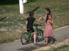 Young Kazakh girls playing by the roadside