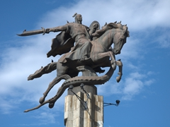 Detail of Manas figure riding a horse Ak-Kul while killing a dragon; in front of the Philharmonic building in Bishkek