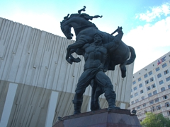 Kojomkul monument erected at the Palace of Sports. Kojomkul was a legendary warrior of the Kyrgyz people based on his sporting achievements