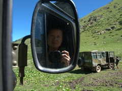Becky scores the front seat in the monster truck on our crazy ride down the mountain; Altyn Arashan