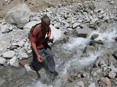 Robby crossing a creek; Ala Archa Park