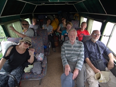 Monster truck time - Russian edition! Dya, Kevin, Lars, Ichi, Becky, Molly, Greg, Chris and Warner smile on the ride up to Altyn Arashan